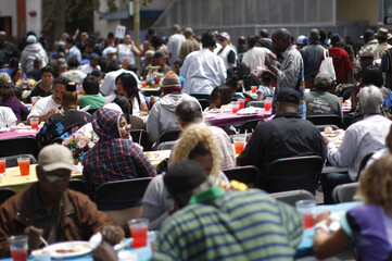 People receive a meal at a Good Friday Easter event sponsored by the Los Angeles Mission to help the homeless and near-homeless of Skid Row in Los Angeles, California.