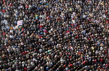 Protesters in Tahrir Square attend a funeral of a protester who died in clashes with riot police, in Cairo