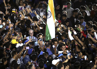 India's captain Mahendra Singh Dhoni makes his way through the crowd, to be presented on stage during the ICC Cricket World Cup 2015 opening event, at the Sidney Myer Music Bowl in Melbourne