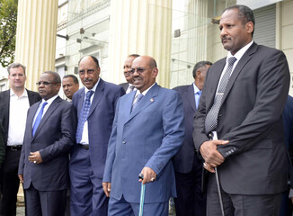 Sudan's President Omar Hassan al-Bashir (2nd R) leaves with his delegation after a meeting in Addis Ababa