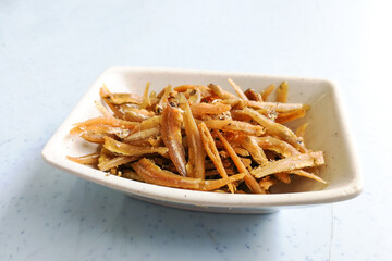 Plate of fried crispy anchovies, Asian recipe