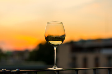 Wine in glasses with sunset background