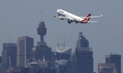 A Qantas Airways jet takes off from Sydney International Airport
