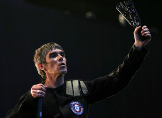 Stone Roses lead singer Ian Brown performs at Finsbury Park in London