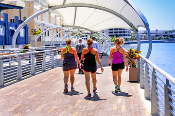 Group of women in jogging clothes on the Riverwalk in downtown Tampa FL