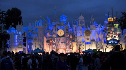 """People wait by the ride """"It's a Small World"""" during Disneyland's Diamond Celebration in Anaheim"""