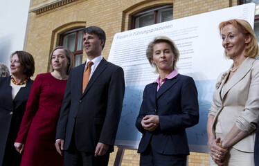 German government and private company officials pose after meeting on women's quota in Berlin