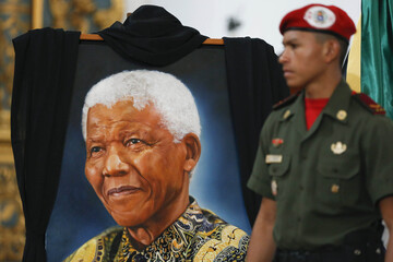 A painting of former South African President Nelson Mandela is displayed during a mass held in his honor in Caracas