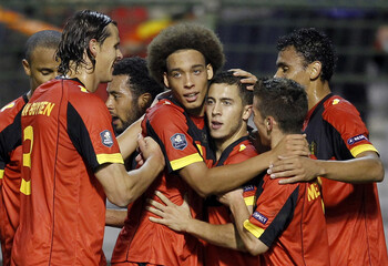 Hazard of Belgium is congratulated by team mates after scoring against Kazakhstan during their Euro 2012 Group A qualifying soccer match in Brussels