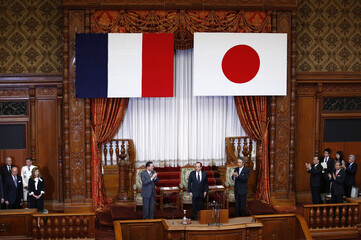 French President Hollande is applauded by Japanese lawmakers after delivering a speech at the Upper House of the parliament in Tokyo
