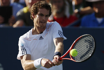 Murray of Britain hits a return to Cilic of Croatia during their men's singles quarterfinals match at the U.S. Open tennis tournament in New York