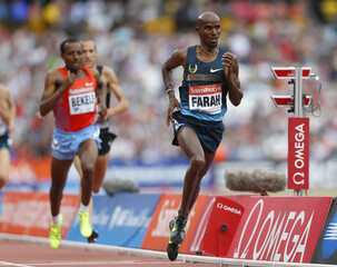 Mo Farah of Britain competes in the men's 3000m at the London Diamond League 'Anniversary Games' athletics meeting at the Olympic Stadium, in east London