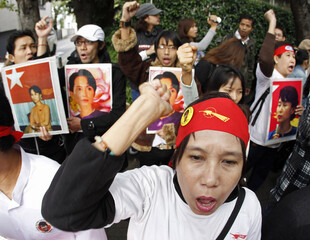 Supporters of Myanmar's detained opposition leader Aung San Suu Kyi shout slogans at a rally outside the Myanmar embassy in Tokyo