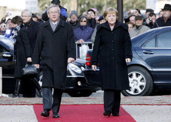 Luxembourg's Prime Minister Juncker welcomes German Chancellor Merkel in Luxembourg