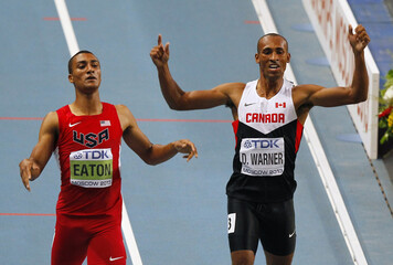Warner celebrates beside Eaton of the U.S. in their men's decathlon 1,500 metres event during the IAAF World Athletics Championships in Moscow