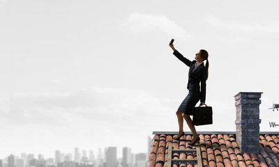 Woman on roof doing selfie