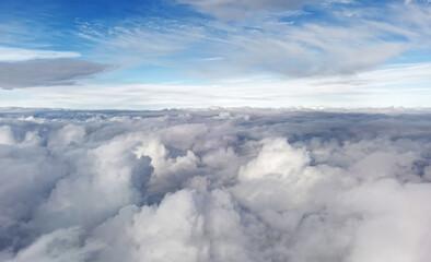 Fototapeta Aerial cloudscape from airplane window.