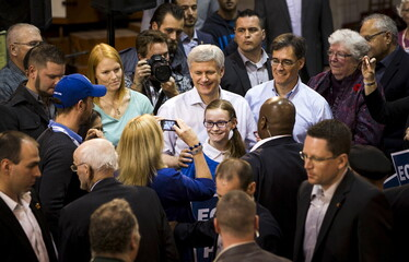 Canada's PM and Conservative leader Harper poses for pictures in Brantford