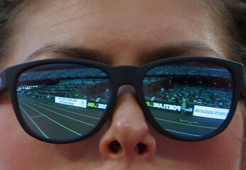 The tracks are relfected on the sunglasses of Vlasic of Croatia as she competes in the women's high jump qualifying round during the 15th IAAF World Championships at the National Stadium in Beijing