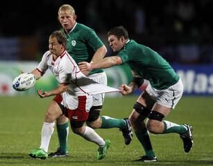 Ireland's Donnacha Ryan grabs onto Russia captain Alexander Yanyushkin during their Rugby World Cup Pool C match at Rotorua International Stadium in Rotorua