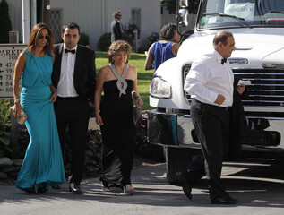 Guests of Chelsea Clinton and Marc Mezvinsky prepare to depart for the couple's wedding in Rhinebeck