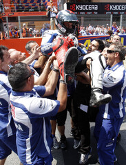 Yamaha MotoGP rider Lorenzo is thrown in the air by his team after he won the Catalan MotoGP in Montmelo