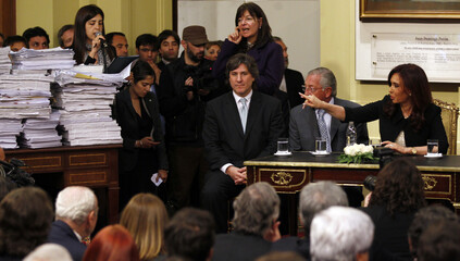 Argentina's President Fernandez de Kirchner points to documents of an investigation into Papel Prensa newsprint supplier in Buenos Aires