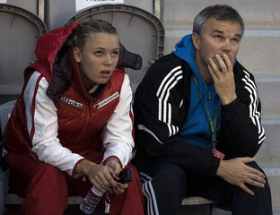 Denmark's Caroline Wozniacki and her father and coach Piotr Wozniacki watch a match before their Fed Cup tennis match against Latvia in Lisbon