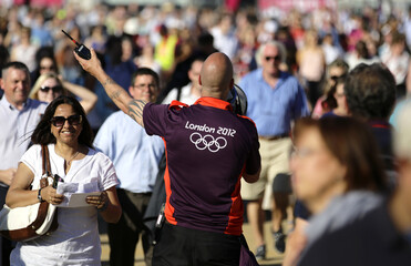 A man directs the crowd as they go into test event at the Olympic Park in Stratford