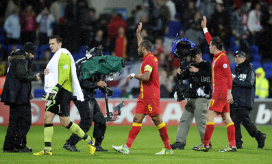Wales' Bale, Williams and Price leave the field after beating Scotland in their World Cup 2014 qualifying soccer match in Cardiff