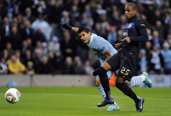 Manchester City's Aguero shoots to score against Porto during their Europa League second leg soccer match in Manchester