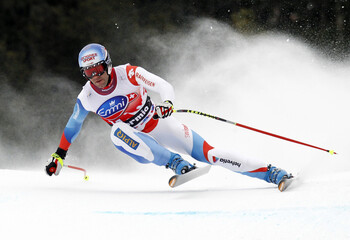 Defago takes a curve on his way to win the men's downhill Alpine Skiing World Cup in Bormio