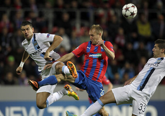 Manchester City's Kolarov and Nastasic challenge Viktoria Plzen's Kolar during their Champions League group D soccer match at the Doosan Arena in Prague, Czech Republic.
