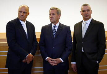 Former German President Christian Wulff and his lawyers Michel Nagel and Bernd Muessig at the regional court in Hanover