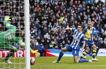 Arsenal's Walcott scores a goal against Brighton and Hove Albion during their FA Cup fourth round soccer match at the Amex stadium in Brighton