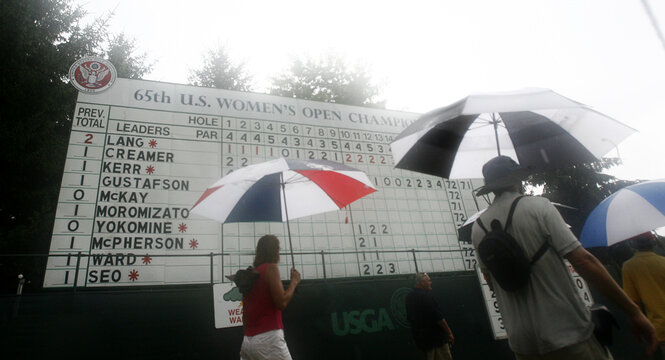 Spectators leave the course after play was suspended for rain and lightning during the second round of the Women's U.S. Open Golf Championship in Oakmont