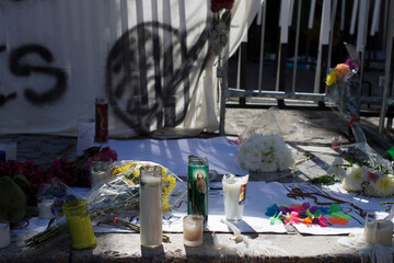 Candles, flowers and signs are seen outside the Blue Parrot nightclub left by people in honor of the dead and injured, after a gunman opened fire early on Monday, during a BPM electronic music festival, in Playa del Carmen