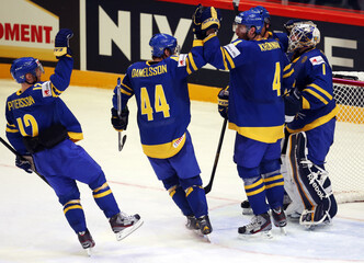 Sweden's players celebrate their victory over the Czech Republic after their 2013 IIHF Ice Hockey World Championship preliminary round match at the Globe Arena in Stockholm