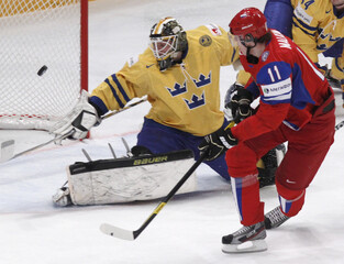 Russia's Malkin tries to score past Sweden's goalkeeper Fasth during their 2012 IIHF men's ice hockey World Championship game in Stockholm