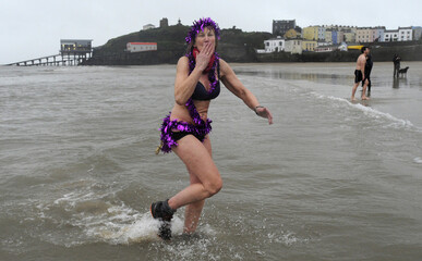 Rosie Swale-Pope joins hundreds of swimmers wearing costumes take part in the annual Tenby Boxing Day swim