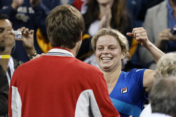 Kim Clijsters greets her husband after her victory against Vera Zvonareva during the U.S. Open tennis tournament in New York