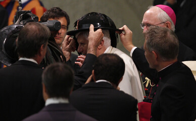 Pope Benedict XVI wears an Italian Bersaglieri hat as he leads the weekly general audience in the Paul VI Hall at the Vatican