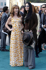 """Comedienne Kathy Griffin and cast member Cher arrive at the world premiere of the film """"Zookeeper"""" in Los Angeles"""