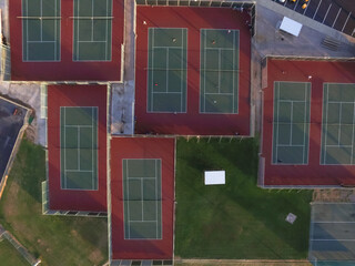 Aerial outdoor tennis court in Houston, Texas, USA at sunset. Urban sport and recreation concept.