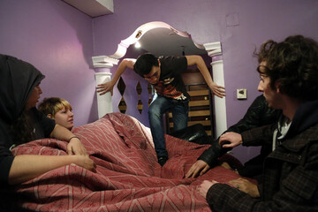 Anti-eviction activists place furniture by the entrance door to the apartment of Montoya Vazquez while waiting for the police to carry out her family's eviction in Madrid