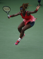 Serena Williams of the U.S. leaps as she returns to compatriot Stephens at the U.S. Open tennis championships in New York