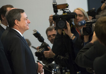 European Central Bank President Draghi poses for media before speaking to German lawmakers in Berlin