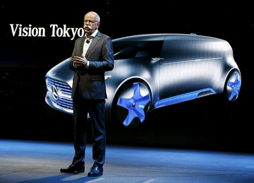 Mercedes Benz Chair Zetsche stands near concept vehicle Vision Tokyo at reception prior to opening of the North American International Auto Show in Detroit