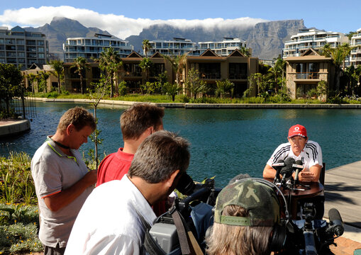 England's coach Andy Flower speaks to the media at the team hotel with Table Mountain in the background in Cape Town
