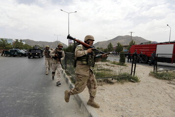 Afghan security forces arrive at the site of an attack near the Afghan parliament in Kabul, Afghanistan